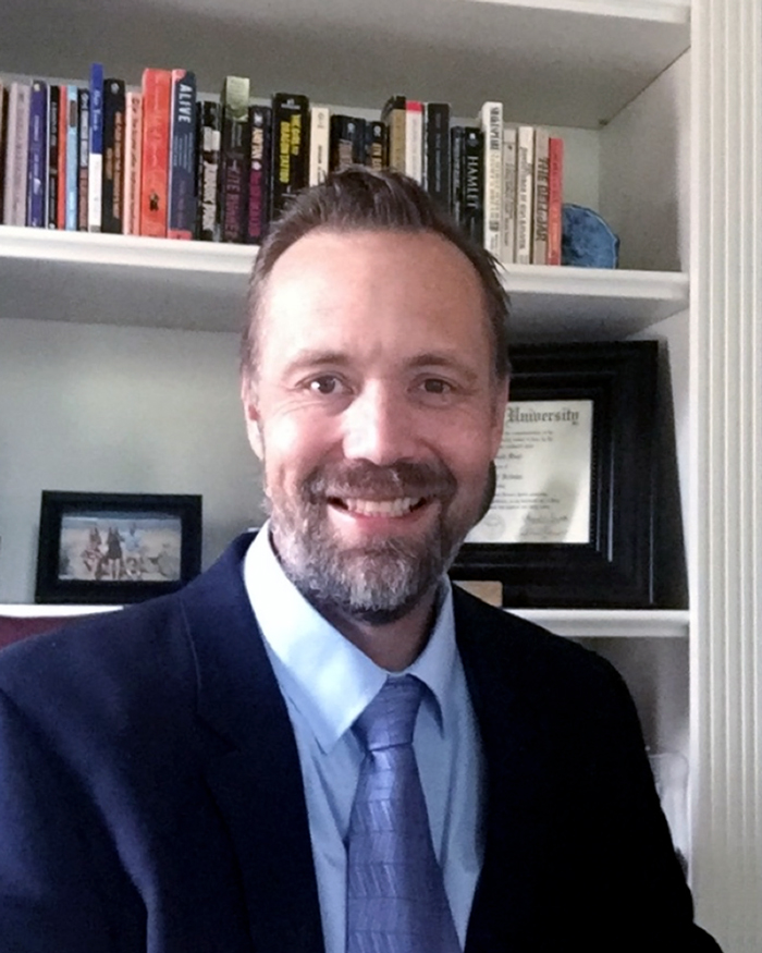 A portrait of Russell Dahl, Ph.D., CEO and Founder